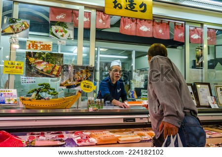 "OSAKA,JAPAN - 17 April,2014:Fresh seafood shop in Kuromon Ichiba market.The market has been called ""Osaka's Kitchen"" since it opened in the mid-Taisho Period (1912-1926)."