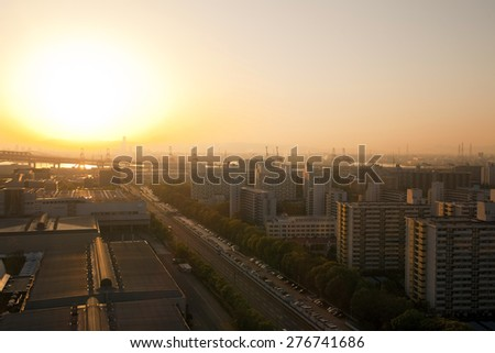 OSAKA, JAPAN - APRIL 21 : Osaka Bay in morning sunlight in Osaka,Japan on April 21,2015. Industries locate around Osaka Bay because there are skilled and plentiful workforce and many port facilities. - stock photo