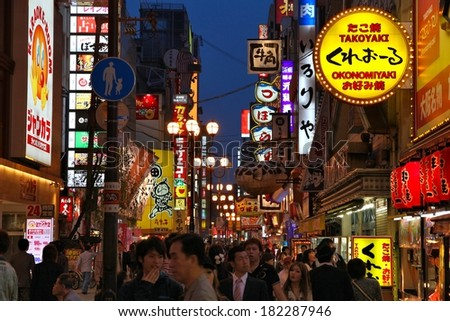 OSAKA, JAPAN - APRIL 25, 2012: People visit famous Dotonbori street in Osaka, Japan. According to Tripadvisor Dotonbori is the 3rd best attraction to visit in Osaka.
