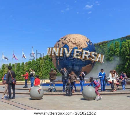 Osaka, Japan - April 27: Tourists and Universal Globe outside the Universal Studios Theme Park in Osaka, Japan on - April 27, 2015. The theme park has many attractions based on the film indust