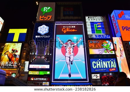 OSAKA, JAPAN - 9 December 2014 : Dotonbori street in Osaka. One of the famous tourist spots in Osaka. People come to see the mascot of Glico which already changed in this year