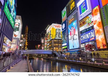 Osaka, Japan - December 4, 2015: The Glico Man billboard and other light displays at Dontonbori, Namba Osaka area, Osaka, Japan. Namba is well known as an entertainment area in Osaka. - stock photo