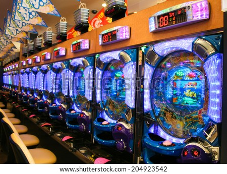 OSAKA, JAPAN - FEBRUARY 20. 2012: Pachinko Machines  used for recreational arcade game and as a gambling device, filling a Japanese gambling niche comparable to slot machines in Western gaming. - stock photo
