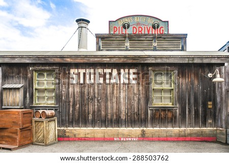 "OSAKA, JAPAN - JUN 2, 2015 : Photo of a building called ""STOCTANE"" with wooden boxes in the front that located inside Universal Studio, Osaka, Japan. Replicated in Cowboy Wild West Theme. - stock photo"