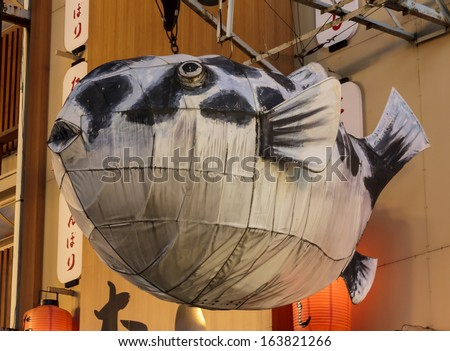 Osaka, Japan - June 20, 2010: A giant fish billboard in Dotombori on  June 20, 2010 in Osaka, Japan. Dotombori is the most important restaurant district and a major tourist destination in Osaka. - stock photo