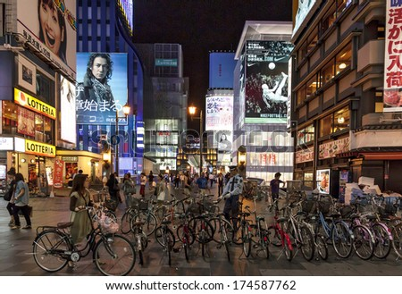 Osaka Japan - June 20, 2010: Bicycle parked in Dotombori district in the background of neon lights on June 20, 2010 in Osaka, Japan. Dotombori is the main entertainment district in Osaka. - stock photo