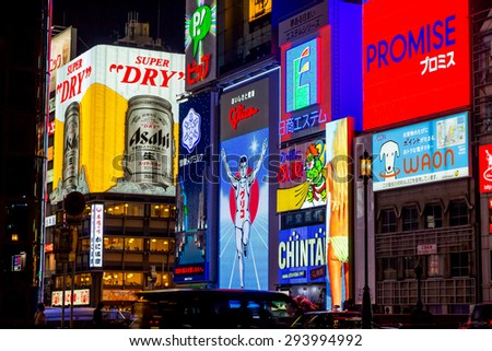 OSAKA, JAPAN - June 11: Dotonbori street in Osaka on June 11, 2015. One of the famous tourist spots in Osaka. People come to see the billboards and well design shop logo