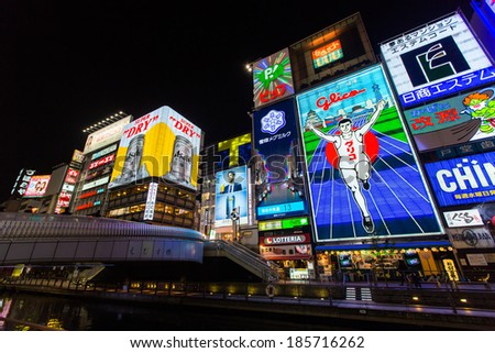 OSAKA, JAPAN - MARCH 23: The Glico Man light billboard and other light displays on March 23, 2014 in Dontonbori, Namba Osaka area, Osaka, Japan. Namba is well known as an entertainment area in Osaka.