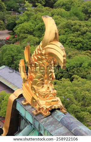 Osaka, Japan - May 28, 2013: Statue of Shachihoko, the mythical creature with a dragon head and a fish body, on the tower roof ridge of Osaka Castle. - stock photo