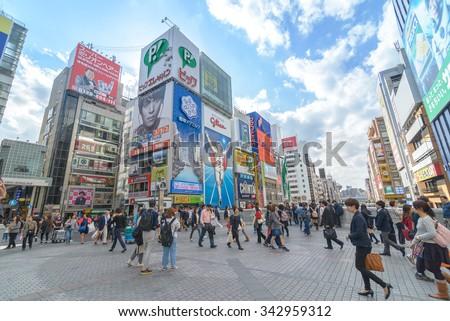 OSAKA, JAPAN - NOV 22, 2015: Dotonbori entertainment district. Dotonbori is one of the principal tourist destinations in Osaka - stock photo