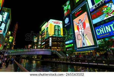 OSAKA, JAPAN - OCTOBER 24: Glico Man in Osaka, Japan on October 24, 2014. Replacing the old neon lights, the 6th gen. of the billboard uses 140,000 LED in total, allows new animated background scenes - stock photo