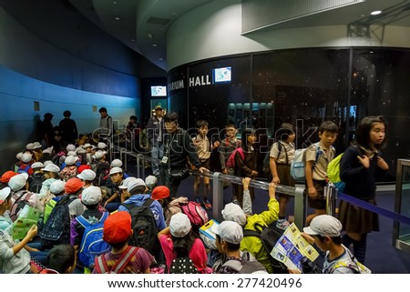 OSAKA, JAPAN - OCTOBER 28: Science Museum in Osaka, Japan on October 28, 2014. Unidentified group of Japanese students  in front of  The Planetarium at Osaka Science Museum - stock photo
