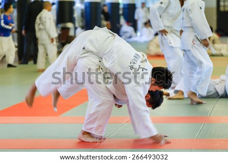 OSAKA, JAPAN - OCTOBER 25: Shudokan Hall in Osaka, Japan on October 25, 2014. Unidentified Japanese students attend the Judo class which is a traditional Matial art at Shudokan hall - stock photo