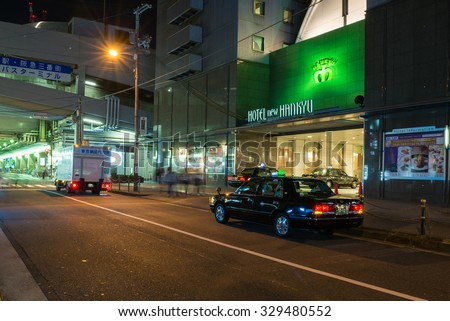 OSAKA, JAPAN - SEPTEMBER 19, 2015: Taxi pulls up in front of the Hotel New Hankyu, Osaka.