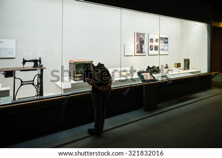 OSAKA, JAPAN - SEPTEMBER 21, 2015: Visitors look at an exhibit in the Osaka Museum of History. - stock photo