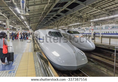 OSAKA - NOV,10 : A Shinkansen train pulls into Shin Osaka Station that  Passengers board the Shinkansen bullet train . All trains stop at Tokyo, Yokohama, Nagoya, Kyoto, and Osaka.JAPAN NOV 10,2015  - stock photo