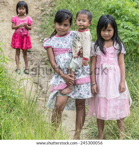 Osango, Sulawesi, Indonesia - August 17, 2014: Group of children of Toraja ethnicity in the countryside of Osango, Mamasa region, West Tana Toraja, Sulawesi, Indonesia. - stock photo