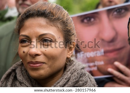 OSLO - MAY 19: Ensaf Haidar, wife of imprisoned Saudi blogger Raif Badawi, protests with activists in front of the Saudi Arabian embassy in Oslo, Norway, to demand his release, May 19, 2015.  - stock photo