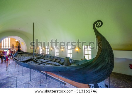 OSLO, NORWAY - 8 JULY, 2015: Beautiful preservation of Osebergskipet as presented in the viking museum at Bygdoy, shot from slightly above angle. - stock photo