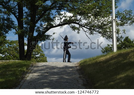 OSLO, NORWAY - JUNE 21: Unidentified guard with rifle in traditional uniform by his hourly turn in the fortress Akershus, a tourist attraction like the British Horse Guards, on June 21, 2009 in Oslo