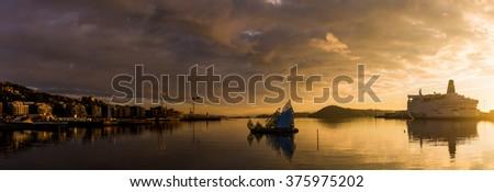 OSLO, NORWAY - NOVEMBER 20, 2015: Oslo at beautiful golden sunset, Norway - stock photo