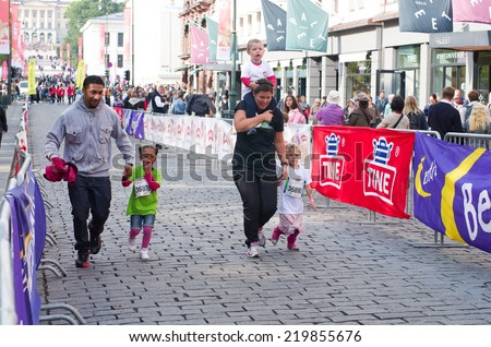 OSLO, NORWAY- SEPT 20:Children's Marathon for all children aged 0-12 years and a day of activities with an obstacle course, gymnastics, hockey and athletics  on Sept 20, 2014 in Oslo, Norway - stock photo