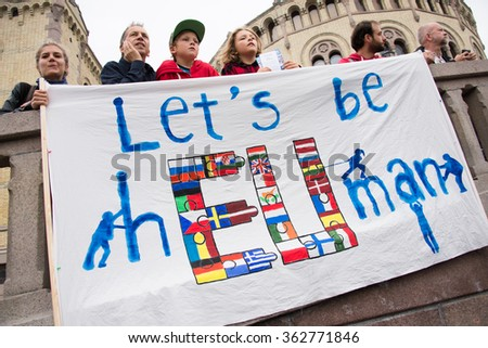 "OSLO - SEPTEMBER 12: Norwegians rallying in support of Syrian refugees hold a banner reading, ""Let's Be Human"" in front of the parliament building in Oslo, Norway, September 12, 2015. - stock photo"