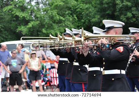 OSSEO, MN - JUNE 26 : The USMC Marine Forces Reserve Band performs in the Osseo Marching Band Festival on June 26, 2010 in Osseo, MN - stock photo
