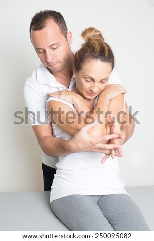 osteopathy older woman - stock photo