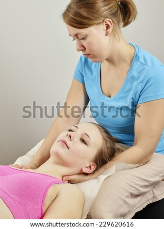Osteopathy treatment the professional masseuse and her patient - stock photo