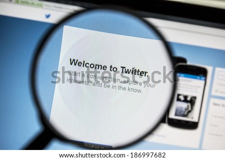 Ostersund, Sweden - April 13, 2014: Twitter website under a magnifying glass. Twitter is a free social networking and microblogging service - stock photo