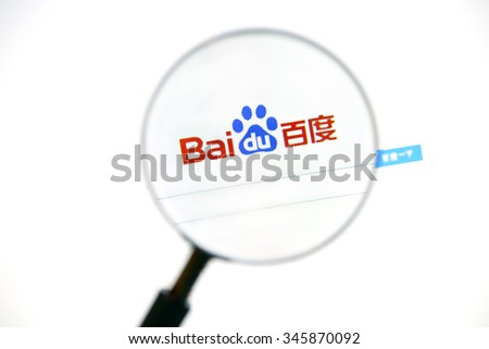 Ostersund, Sweden -December 1, 2015: Baidu webpage under a magnifying glass. Baidu, Inc.  is a Chinese web services company headquartered at the Baidu Campus in Beijing. - stock photo