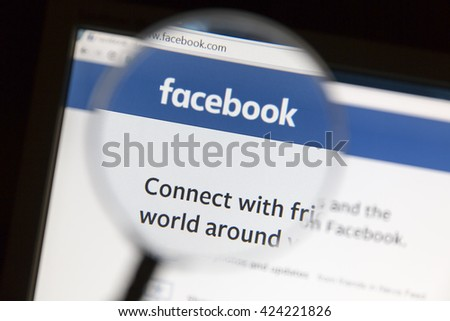 Ostersund, Sweden - May 22, 2016: Facebook's website under a magnifying glass. Facebook is the most visited social network in the world. - stock photo