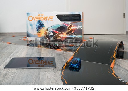 OSTFILDERN, GERMANY - NOVEMBER 1, 2015: Test drive of the new Anki Overdrive smart toy car racing using an app on the Apple iPad to steer the small cars. US producer Anki created an innovative toy - stock photo