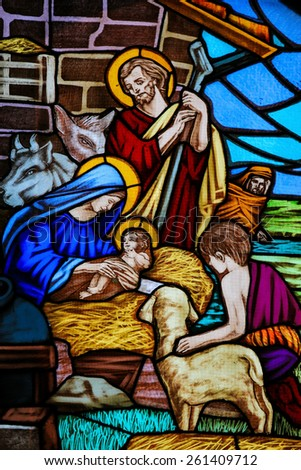 OSTUNI, ITALY - MARCH 14, 2015: Stained glass window depicting a Nativity Scene and the Adoration of the Shepherds in the Church of Ostuni, Apulia, Italy. - stock photo