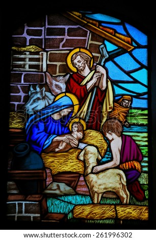 OSTUNI, ITALY - MARCH 14, 2015: Stained glass window depicting a Nativity Scene and the Adoration of the Shepherds in the Church of Ostuni, Apulia, Italy.