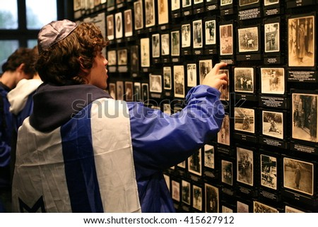 OSWIECIM, POLAND - APRIL 16, 2015: International Holocaust Remembrance Day. People from the all the world meets on the March of the Living in german Concentration Camp in Auschwitz Birkenau.Poland  - stock photo