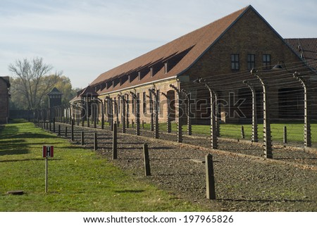 OSWIECIM, POLAND - OCT 29: Buildings in the former German concentration camp in Oswiecim, Poland on October 29, 2013. Oswiecim was the largest German concentration camp in Poland during World War II. - stock photo