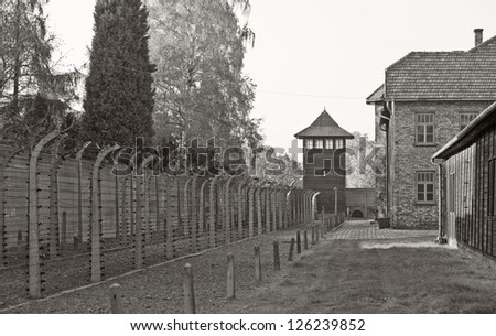 OSWIECIM, POLAND - OCTOBER 22: Barbed wire in Auschwitz Camp I, a former Nazi extermination camp on October 22, 2012 in Oswiecim, Poland. It was the biggest nazi concentration camp in Europe.
