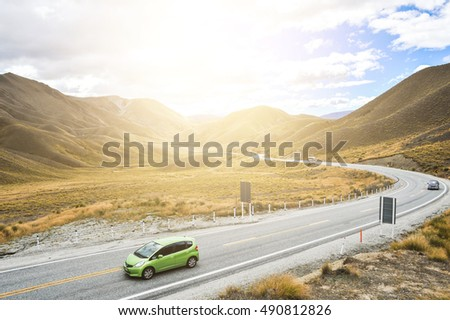 OTAGO, NEW ZEALAND - MARCH: Moving car drive at Lindis Pass with gold light on March, 2015, Otago, New Zealand