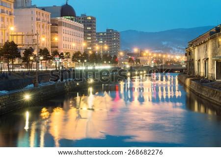 Otaru, Hokkaido, Japan - March 27., 2015: The beautiful Otaru canal and old warehouse. - stock photo