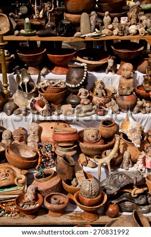 OTAVALO, ECUADOR - FEBRUARY 27, 2010: Stall with indigenous pottery figures in the popular Otavalo market. - stock photo