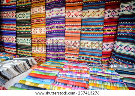 OTAVALO, ECUADOR - JAN 7, 2015: Colorful Souvenirs of the Otavalo market  designed and built in 1970 by Dutch architect Tonny Zwollo