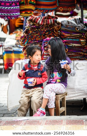 OTAVALO, ECUADOR - JAN 3, 2015: Unidentified Ecuadorian brother and sister at the Otavalo Market. 71,9% of Ecuadorian people belong to the Mestizo ethnic group - stock photo