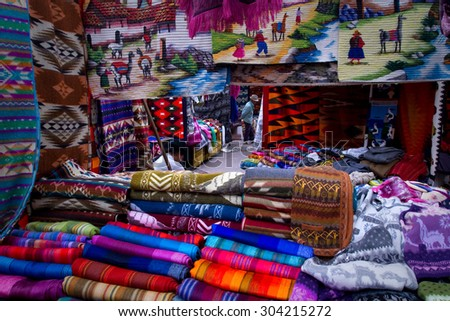 OTAVALO, ECUADOR - MAY 18, 2013: Colorful textile stall in the popular Otavalo market.