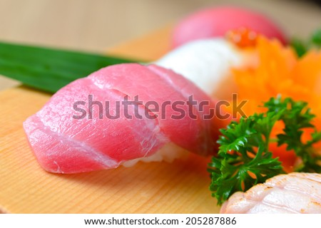 Otoro Sushi (Makuro) on wooden plate decoration - stock photo