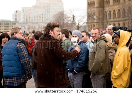 """OTTAWA - APR 20:  Mike Smith (Bubbles), L, and Robb Wells (Ricky) are filmed on Parliament Hill as part of the third Trailer Park Boys movie """"Don't Legalize It""""  Apr 20, 2013 in Ottawa, Canada. - stock photo"""