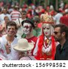 OTTAWA, CANADA - JULY 1: Three youth with their faces painted during Canada Day on July 1, 2013 in downtown Ottawa, Ontario. - stock photo