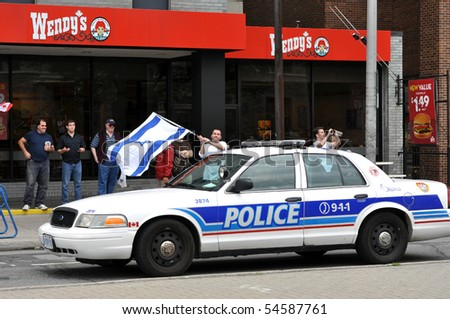 OTTAWA, CANADA - JUNE 5:  A few people gather to show support for Israel across the street from an anti-Israeli protest.  Ottawa, Ontario June 5, 2010. - stock photo