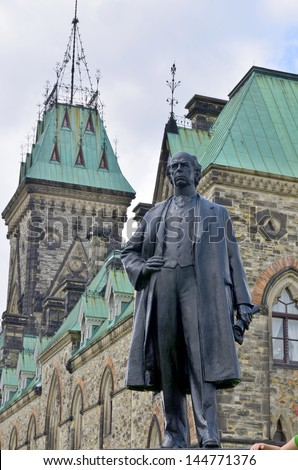 OTTAWA CANADA JUNE 30: Bronze of Sir Wilfrid Laurier (Henri Charles Wilfrid Laurier) was the seventh Prime Minister of Canada from 11 July 1896 to 6 October 1911. On june 30 2013 in Ottawa Canada - stock photo